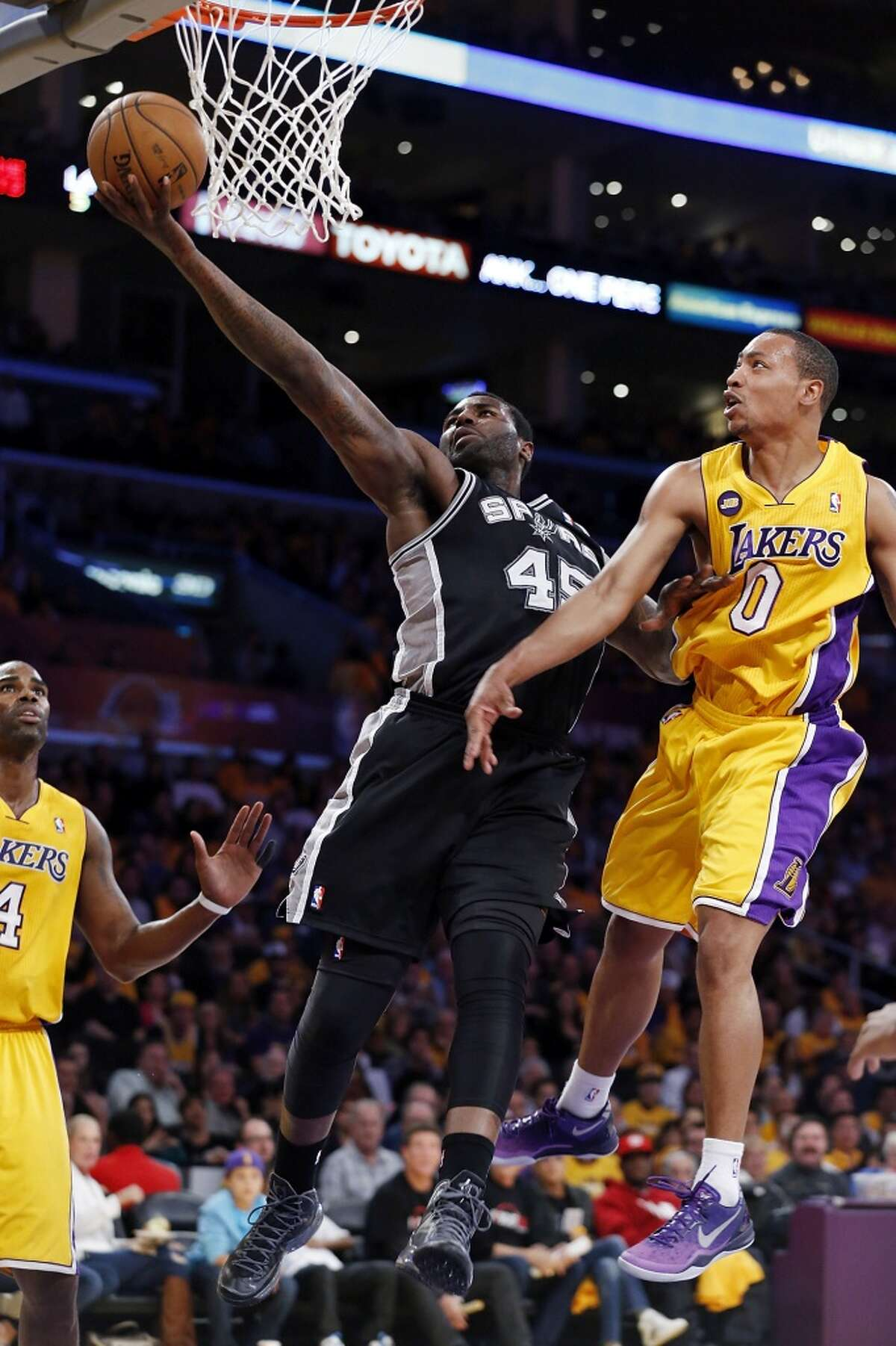 San Antonio Spurs' DeJuan Blair shoots around Los Angeles Lakers' Andrew Goudelock as Los Angeles Lakers' Antawn Jamison (left) looks on during first half action of game 3 in the first round of the NBA Playoffs Friday April 26, 2013 at the Staples Center in Los Angeles, CA.
