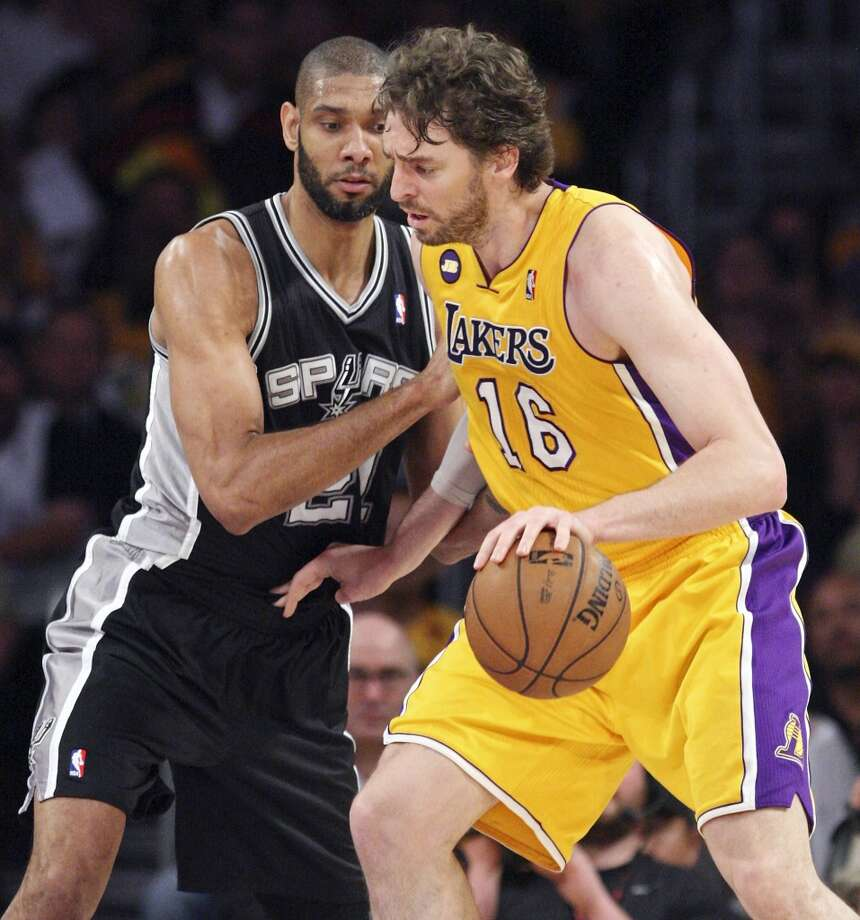San Antonio Spurs' Tim Duncan defends Los Angeles Lakers' Pau Gasol during first half action of game 3 in the first round of the NBA Playoffs Friday April 26, 2013 at the Staples Center in Los Angeles, CA.