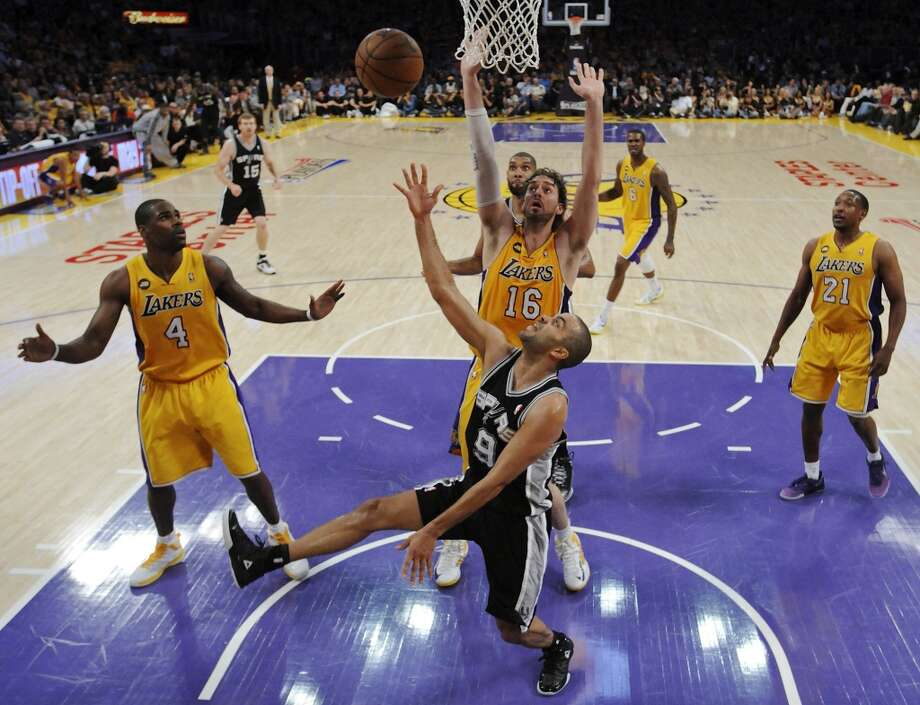 San Antonio Spurs' Tony Parker shoots around Los Angeles Lakers' Antawn Jamison (left) and Los Angeles Lakers' Pau Gasol during first half action of game 3 in the first round of the NBA Playoffs Friday April 26, 2013 at the Staples Center in Los Angeles, CA.