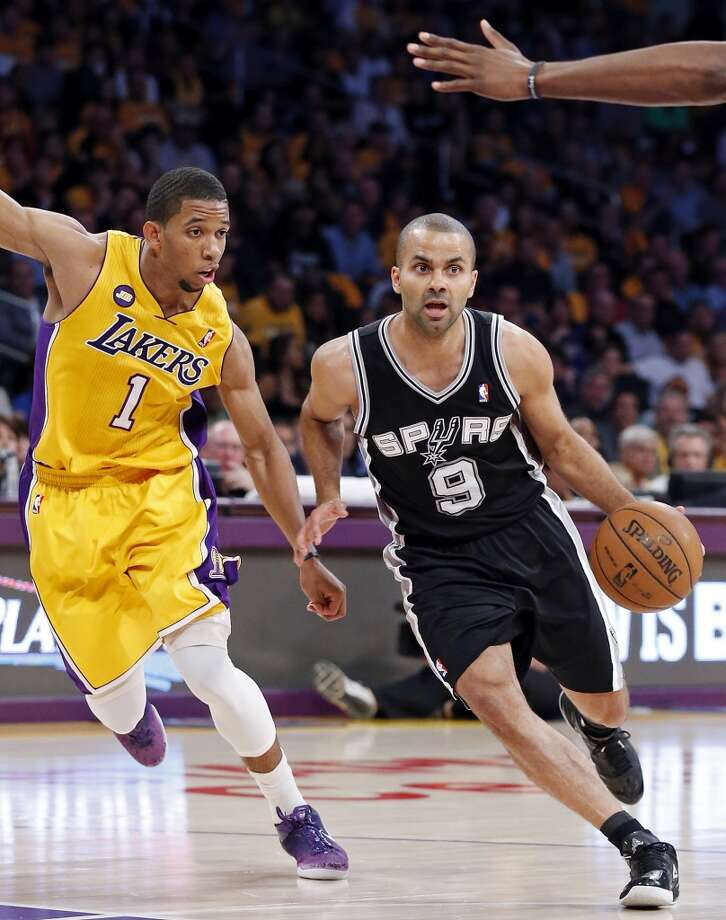 San Antonio Spurs' Tony Parker drives around Los Angeles Lakers' Darius Morris during first half action of game 3 in the first round of the NBA Playoffs Friday April 26, 2013 at the Staples Center in Los Angeles, CA.