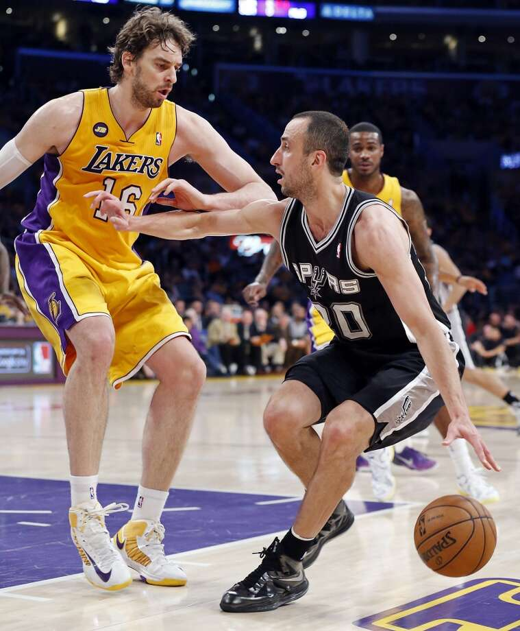 San Antonio Spurs' Manu Ginobili looks for room around Los Angeles Lakers' Pau Gasol during first half action of game 3 in the first round of the NBA Playoffs Friday April 26, 2013 at the Staples Center in Los Angeles, CA.