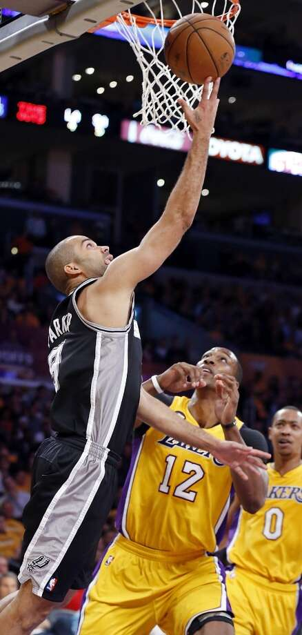 San Antonio Spurs' Tony Parker shoots around Los Angeles Lakers' Dwight Howard during first half action of game 3 in the first round of the NBA Playoffs Friday April 26, 2013 at the Staples Center in Los Angeles, CA.