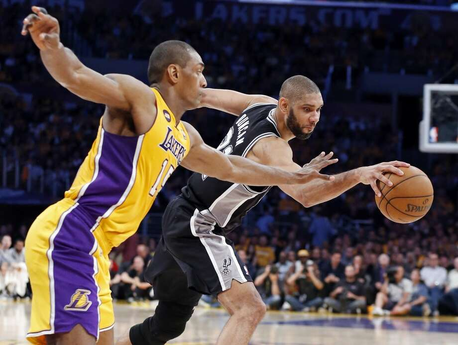 San Antonio Spurs' Tim Duncan and Los Angeles Lakers' Metta World Peace grab for a loose ball during first half action of game 3 in the first round of the NBA Playoffs Friday April 26, 2013 at the Staples Center in Los Angeles, CA.