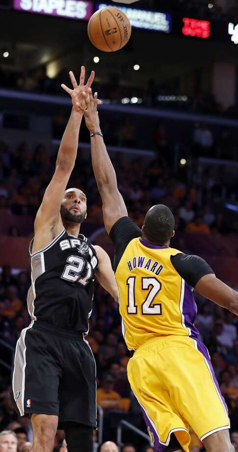 San Antonio Spurs' Tim Duncan shoots over Los Angeles Lakers' Dwight Howard during first half action of game 3 in the first round of the NBA Playoffs Friday April 26, 2013 at the Staples Center in Los Angeles, CA.