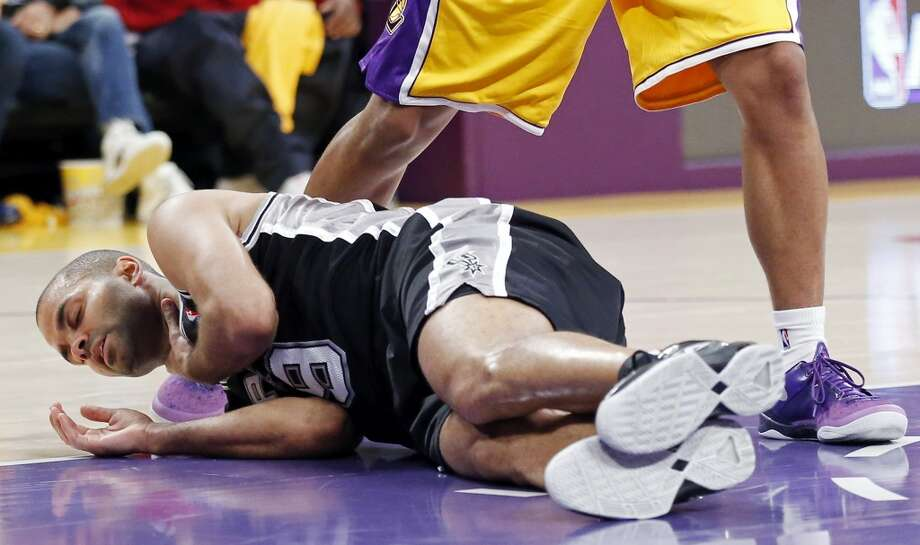 San Antonio Spurs' Tony Parker lies on the floor after being injured during first half action of game 3 in the first round of the NBA Playoffs against the Los Angeles Lakers Friday April 26, 2013 at the Staples Center in Los Angeles, CA.