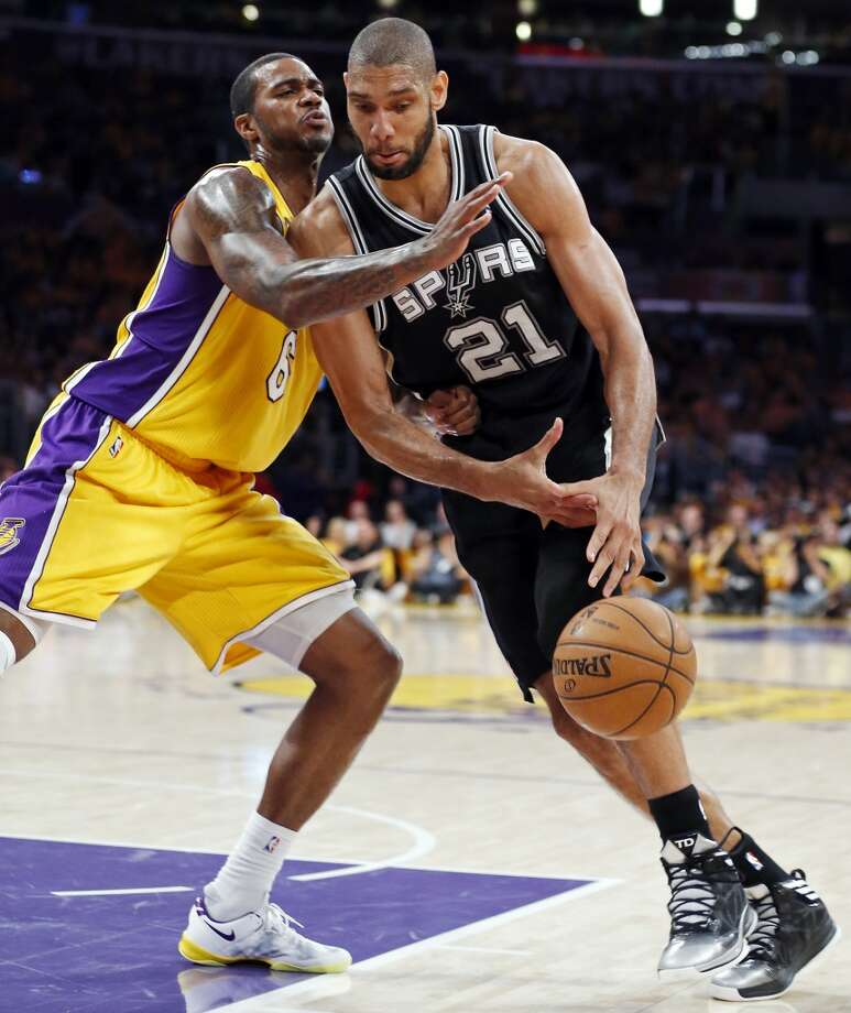 San Antonio Spurs' Tim Duncan looks for room around Los Angeles Lakers' Earl Clark during second half action of game 3 in the first round of the NBA Playoffs Friday April 26, 2013 at the Staples Center in Los Angeles, CA. The Spurs won 120-89.