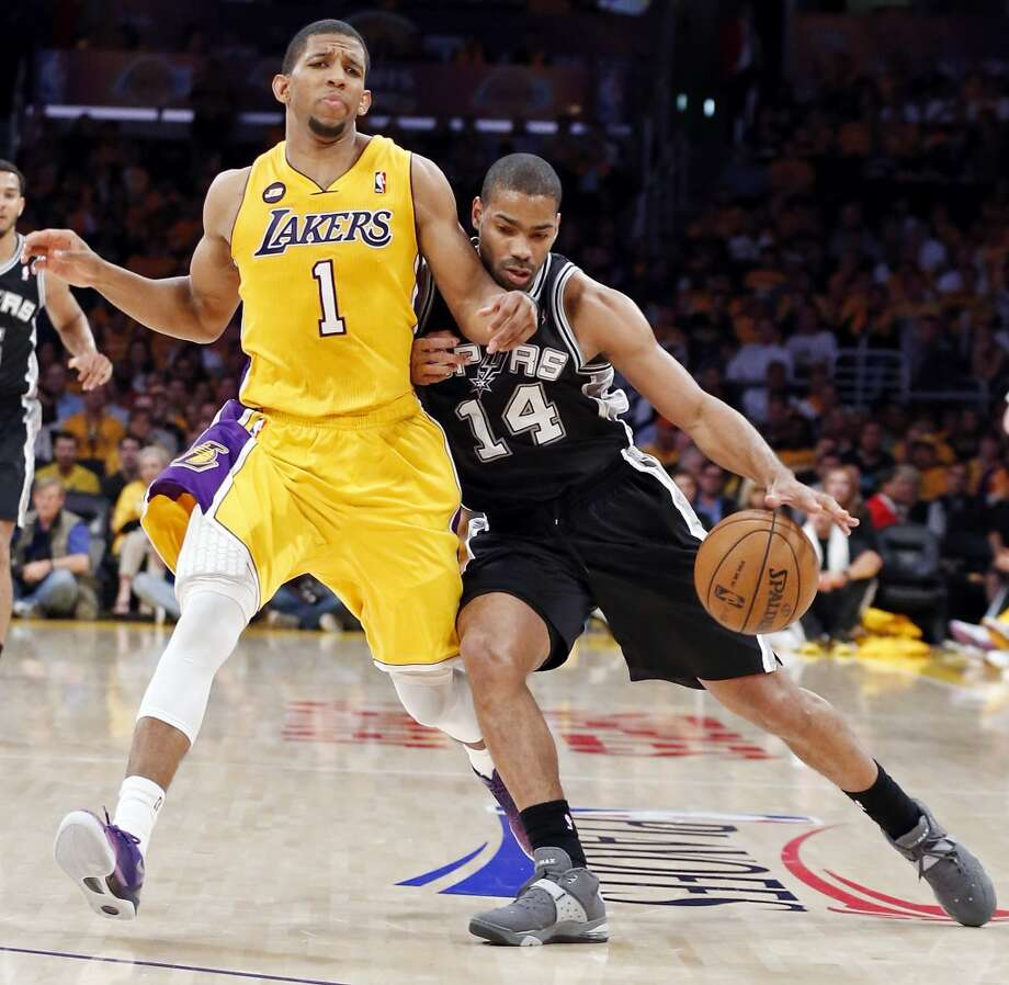 San Antonio Spurs' Gary Neal looks for room around Los Angeles Lakers' Darius Morris during second half action of game 3 in the first round of the NBA Playoffs Friday April 26, 2013 at the Staples Center in Los Angeles, CA. The Spurs won 120-89.