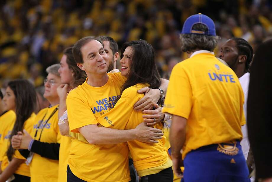 Warriors owner Joe Lacob hugs his fiancee Nicole Curran in the second half. The Golden State Warriors played the Denver Nuggets in Game 3 of the first round of the NBA playoffs at Oracle Arena in Oakland, Calif., on Friday, April 26, 2013. The Warriors won the game 110-108 Photo: Lance Iversen, The Chronicle