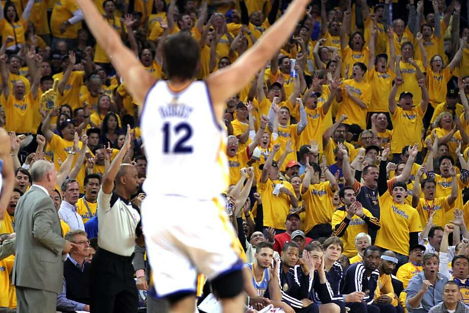 Warriors fans, donning the gold shirts they found on their seats Friday, join Andrew Bogut, wearing No. 12, in cheering a three-point play by Carl Landry, not pictured. Below, excited fans react after Stephen Curry scores. Photo: Lance Iversen, The Chronicle