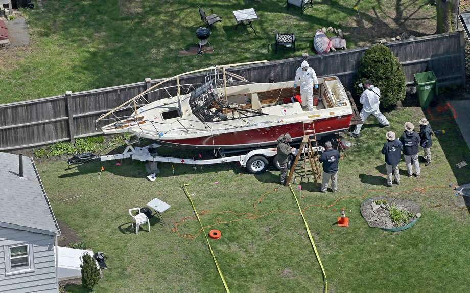 The boat where the second suspect in the Boston Marathon bombings was found is inspected by the FBI in Watertown, Mass., April 22, 2013.  (David L. Ryan/Boston Globe) - Photo: DAVID L. RYAN, New York Times / BOSTON GLOBE