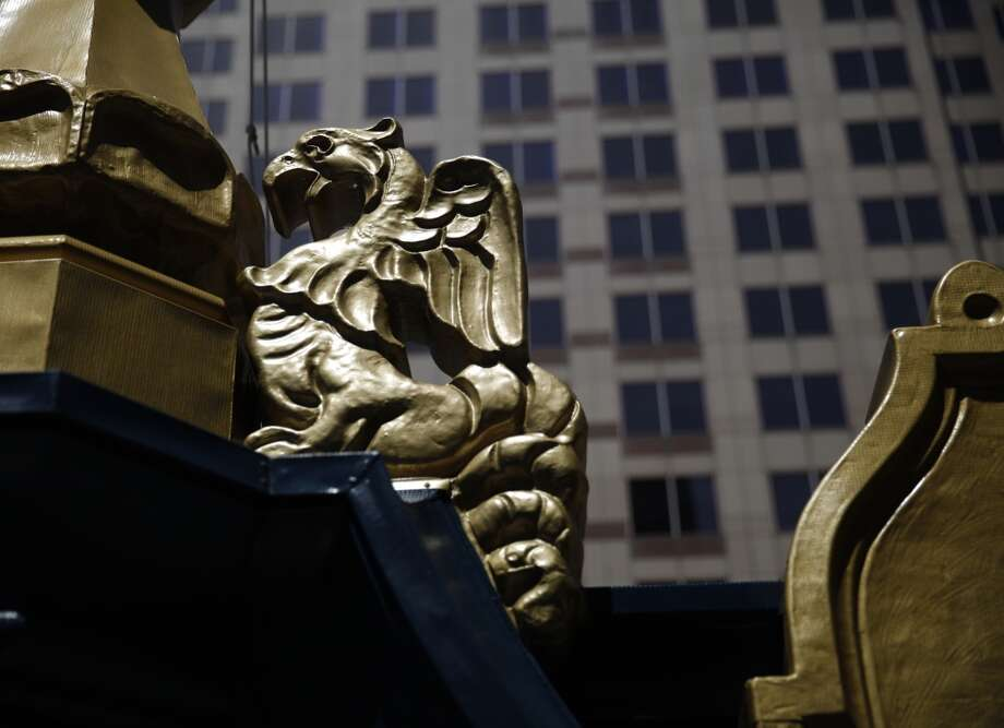 A griffin is seen next to the flagpole atop the Hallidie Building on Monday, April 22, 2013 in San Francisco, Calif. The building underwent rehabilitation to repair the decorative sheet metal frieze panels and cornices, balconies, and fire escapes and repainted in its original blue and gold. It is believed to be the first American building to feature a glass curtain wall.