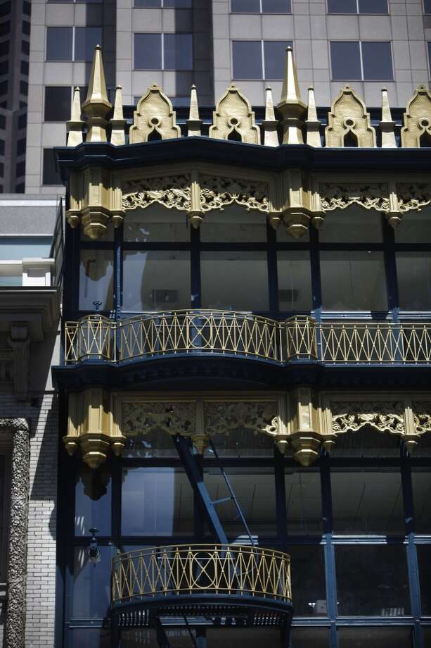 A cornice, balcony and part of the curtain wall are seen on the Hallidie Building on Friday, April 26, 2013 in San Francisco, Calif. The building underwent rehabilitation to repair the decorative sheet metal frieze panels and cornices, balconies, and fire escapes and repainted in its original blue and gold. It is believed to be the first American building to feature a glass curtain wall.
