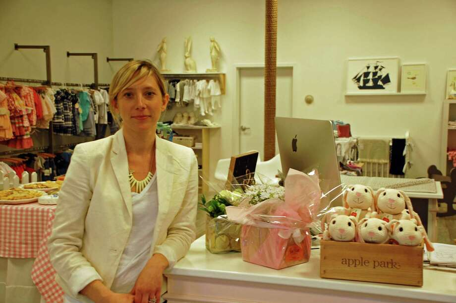 With the help of her 4-year-old daughter, Evelina Socha opened Pink Lemon Blue Lime, a  children's clothing boutique, at the Goodwives Shopping Center in Darien. For the Darien News/Jarret Liotta Photo: Contributed