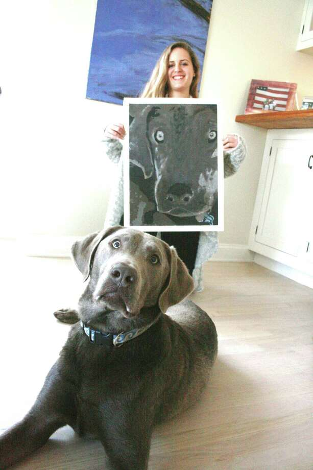 """Althea Perley, a senior at Darien High School and her dog, Rudy, show off """"Woof,"""" one of her entries for the 55th annual Darien Arts Center show and sale, which will be receiving art May 26 and 28. Photo: Contributed"""