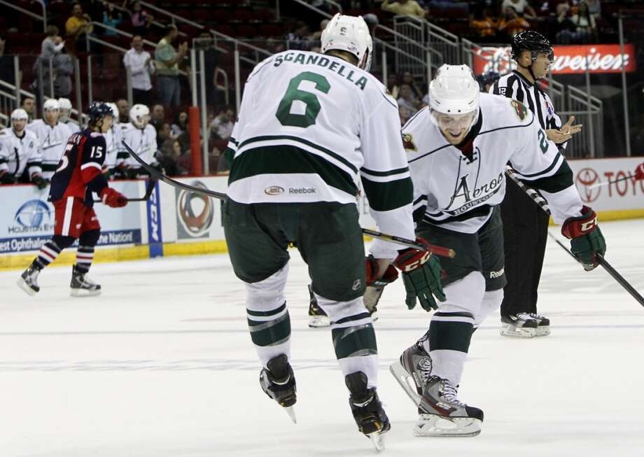 Aeros defenseman Steven Kampfer, right, congratulates teammate Marco Scandella after Scandella scored a goal during the second period of their first playoff game against the Grand Rapids Griffins at the Toyota Center Friday, April 26, 2013, in Houston. The Aeros won 3-0. (Cody Duty / Houston Chronicle)