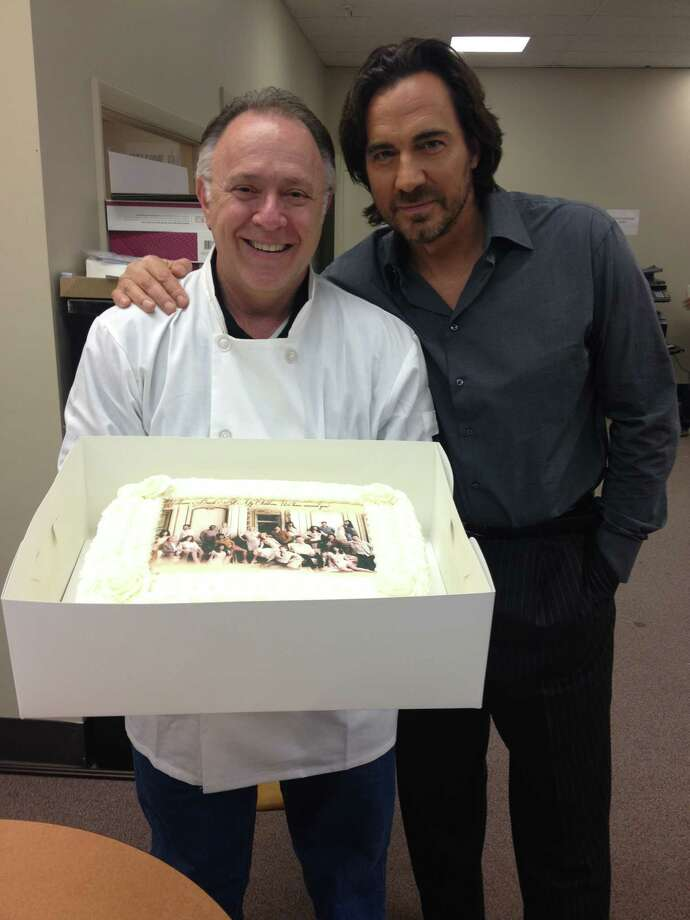Sky Mercede, co-owner of Forever Sweet Bakery, presents Thorsten Kaye (Zack) from All My Children0 with a cake in Stamford. Photo: Contributed Photo