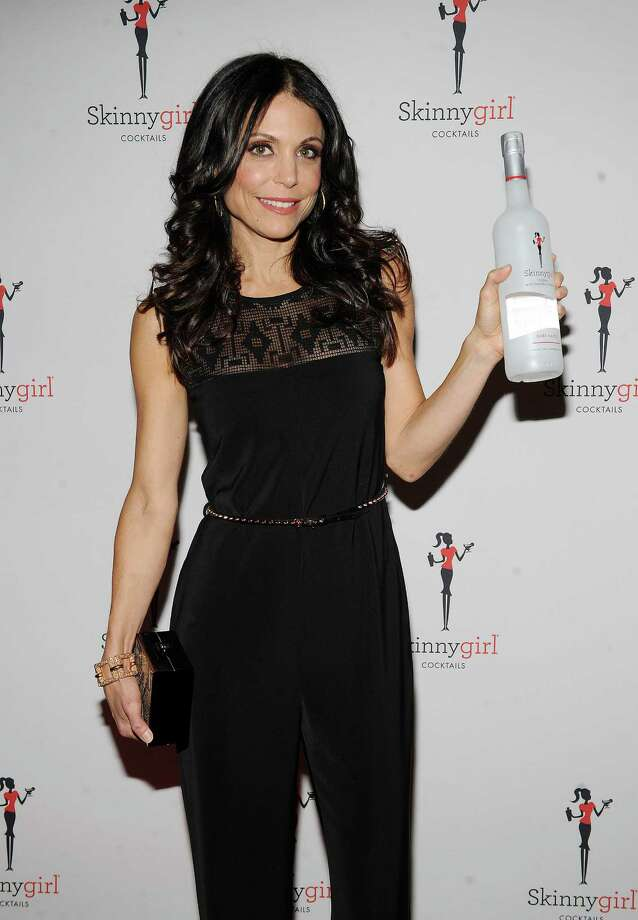 "FILE - This Oct. 12, 2012 file photo originally released by Skinnygirl Cocktails shows TV personality Bethenny Frankel at the Skinnygirl Cocktails event during the New York City Wine & Food Festival in New York. Frankel plans to expand her Skinnygirl line of wine and spirits and power bars to include more food products. Frankel, whose entrepreneurial reach also includes diet books and videos, and a novel, had a six-city run of ""bethenny"" on Fox-owned stations last year. The show will air in cities across the country this fall.  (AP Photo/Skinnygirl Cocktails, Scott Gries) Photo: Scott Gries"