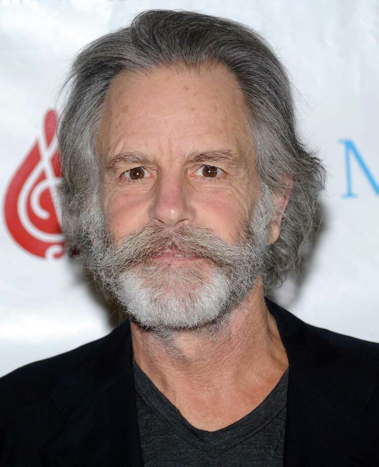 FILE - This Feb. 24, 2010 file photo shows musician Bob Weir at SIRIUS XM Radio in New York. Weir fell onstage while strumming his guitar at a concert in Port Chester, N.Y. In a video posted online, the 65-year-old musician collapsed Thursday during a performance with his Furthur bandmates at The Capitol Theatre. He was quickly helped off the floor as the crowd cheered him on. Weir is currently on a tour with Furthur, the band he formed with fellow Grateful Dead bandmate Phil Lesh. Lesh told the crowd Thursday that Weir had been suffering from a strained shoulder. (AP Photo/Evan Agostini, file) Photo: Evan Agostini