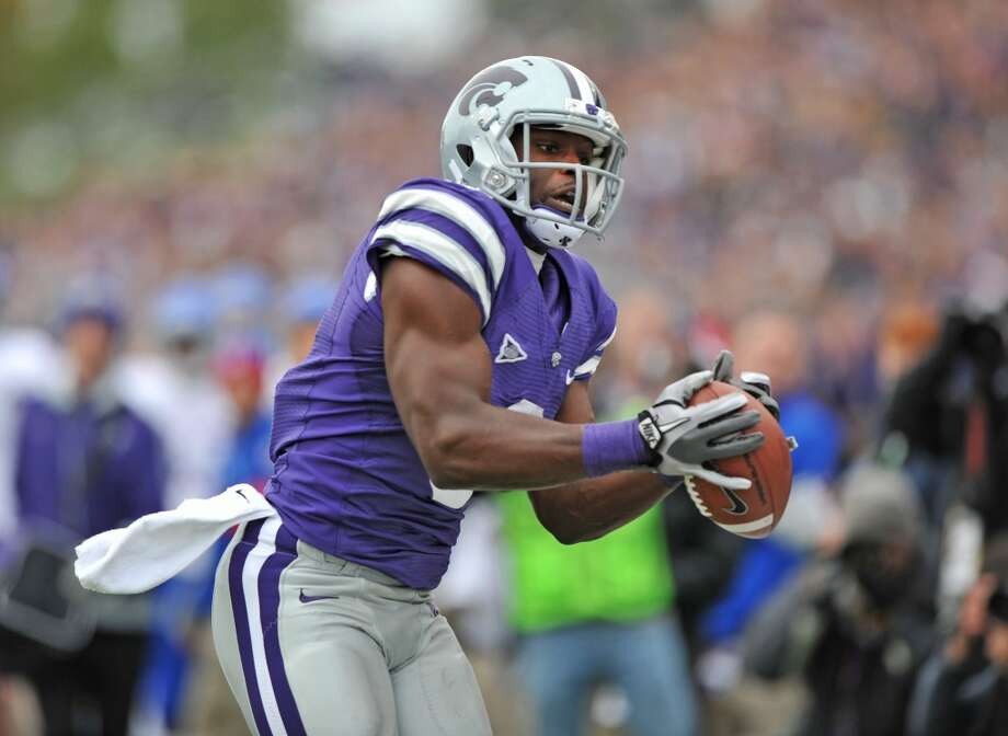 MANHATTAN, KS - OCTOBER 06:  Wide receiver Chris Harper #3 of the Kansas State Wildcats catches a 37-yard pass against the Kansas Jayhawks during the third quarter on October 6, 2012 at Bill Snyder Family Stadium in Manhattan, Kansas.  Kansas State defeated Kansas 56-16.  (Photo by Peter G. Aiken/Getty Images)
