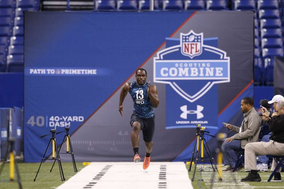 INDIANAPOLIS, IN - FEBRUARY 24: Chris Harper of Kansas State runs the 40-yard dash during the 2013 NFL Combine at Lucas Oil Stadium on February 24, 2013 in Indianapolis, Indiana. (Photo by Joe Robbins/Getty Images)