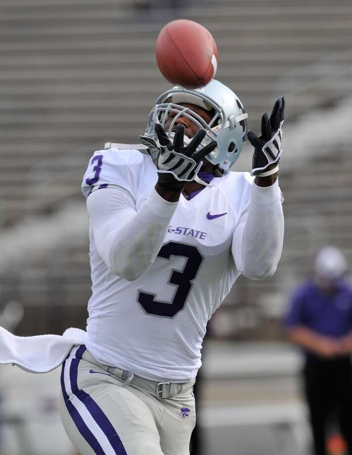 MANHATTAN, KS - APRIL 24:  Wide receiver Chris Harper #3 of the Kansas State Wildcats catches a pass during the Wildcats spring game on April 24, 2010 at Bill Snyder Family Stadium in Manhattan, Kansas.  (Photo by Peter G. Aiken/Getty Images)