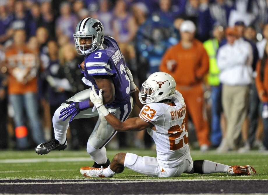 MANHATTAN, KS - DECEMBER 01:  Wide receiver Chris Harper #3 of the Kansas State Wildcats turns up field after catching a pass against defensive back Carrington Byndom #23 of the Texas Longhorns during the first half on December 1, 2012 at Bill Snyder Family Stadium in Manhattan, Kansas.  (Photo by Peter G. Aiken/Getty Images)
