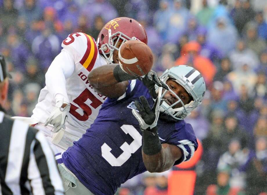 MANHATTAN, KS - DECEMBER 03:  Defensive back Jeremy Reeves #5 of the Iowa State Cyclones brakes up a pass in the end zone against wide receiver Chris Harper #3 of the Kansas State Wildcats during the first half on December 3, 2011 at Bill Snyder Family Stadium in Manhattan, Kansas.  Kansas State defeated Iowa State 27-20.  (Photo by Peter G. Aiken/Getty Images)
