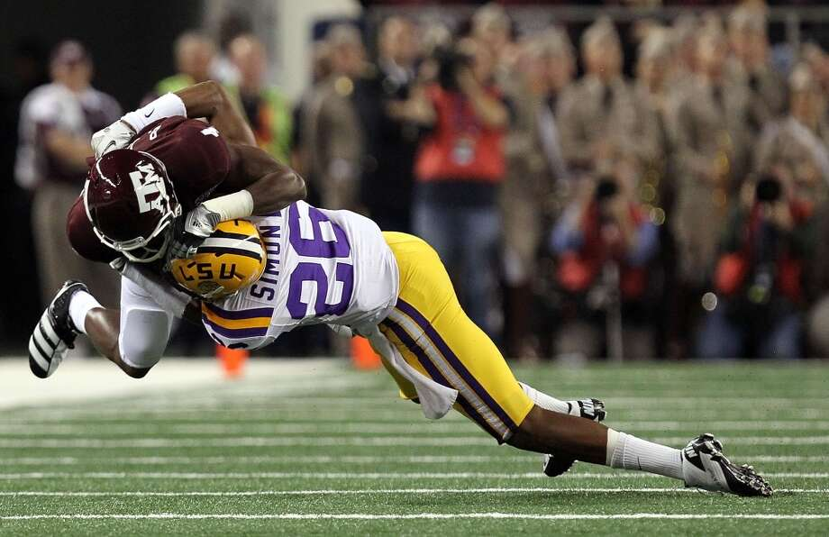 ARLINGTON, TX - JANUARY 07:  Wide receiver Brandal Jackson #4 of the Texas A&M Aggies is tackled by Tharold Simon #26 of the LSU Tigers during the AT&T Cotton Bowl at Cowboys Stadium on January 7, 2011 in Arlington, Texas.  (Photo by Ronald Martinez/Getty Images)