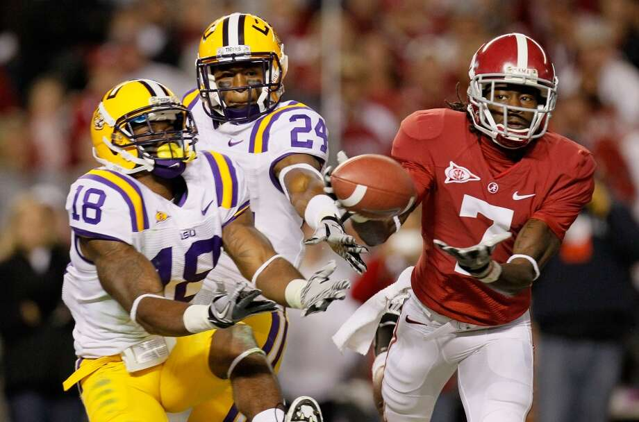 TUSCALOOSA, AL - NOVEMBER 05:  Kenny Bell #7 of the Alabama Crimson Tide fails to pull in his touchdown attempt against Brandon Taylor #18 and Tharold Simon #24 of the LSU Tigers at Bryant-Denny Stadium on November 5, 2011 in Tuscaloosa, Alabama.  (Photo by Kevin C. Cox/Getty Images)
