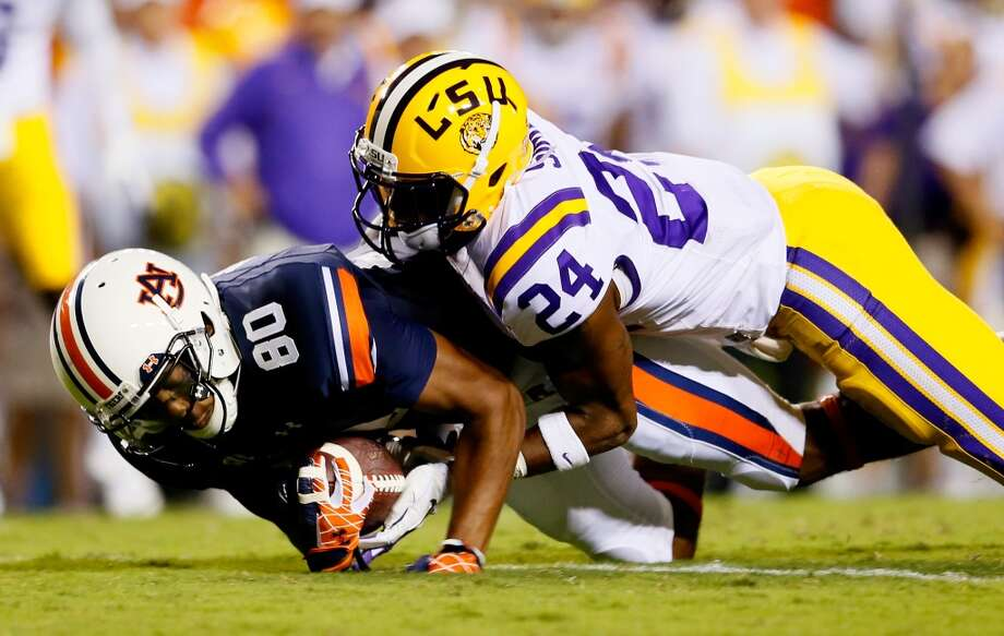 AUBURN, AL - SEPTEMBER 22:  Emory Blake #80 of the Auburn Tigers pulls in this reception against Tharold Simon #24 of the LSU Tigers at Jordan Hare Stadium on September 22, 2012 in Auburn, Alabama.  (Photo by Kevin C. Cox/Getty Images)