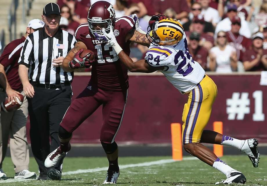 COLLEGE STATION, TX - OCTOBER 20:  Mike Evans #13 of the Texas A&M Aggies runs the ball against Tharold Simon #24 of the LSU Tigers at Kyle Field on October 20, 2012 in College Station, Texas.  (Photo by Ronald Martinez/Getty Images)