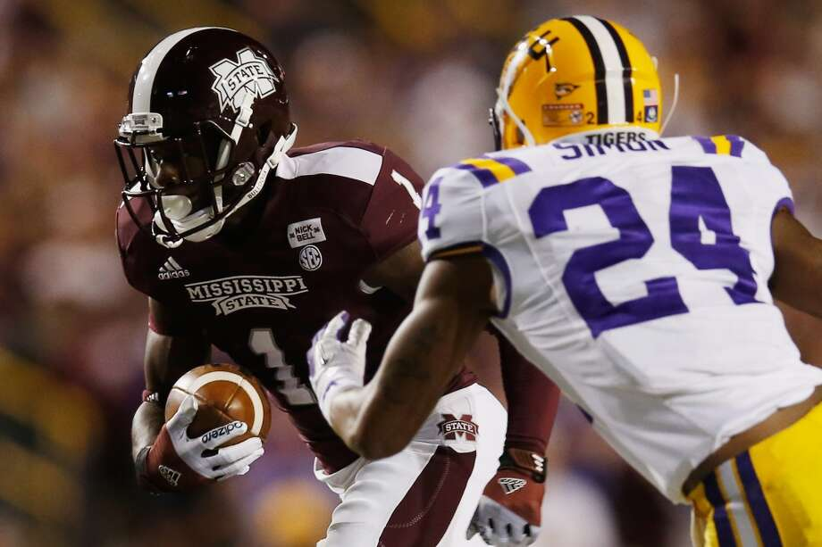 BATON ROUGE, LA - NOVEMBER 10:  Chad Bumphis #1 of the Mississippi State Bulldogs runs past Tharold Simon #24 of the LSU Tigers at Tiger Stadium on November 10, 2012 in Baton Rouge, Louisiana.  (Photo by Chris Graythen/Getty Images)