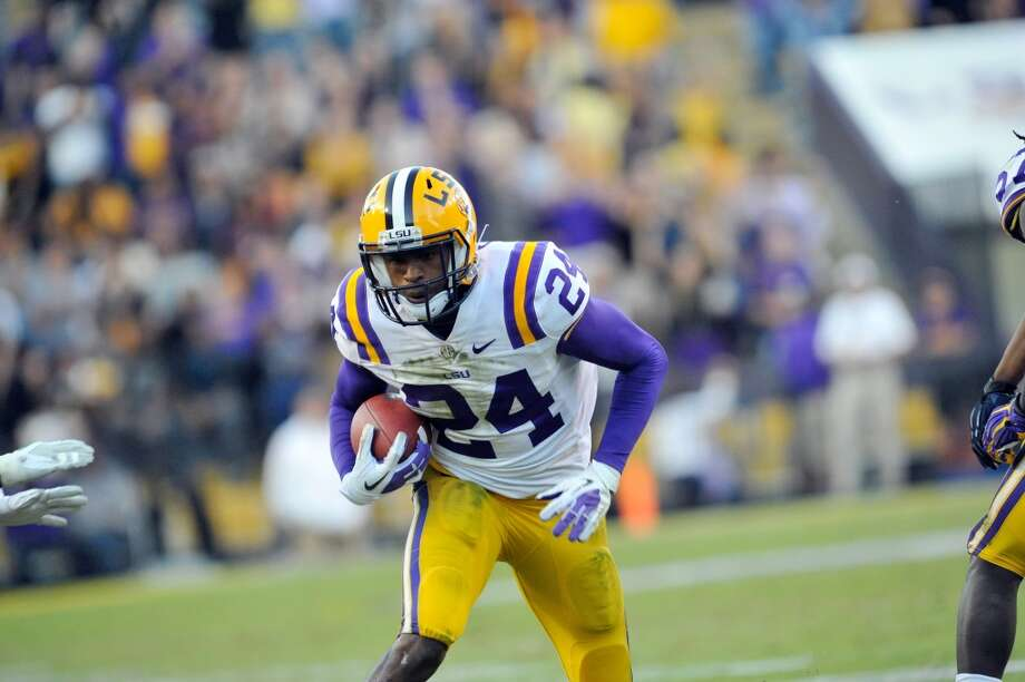 BATON ROUGE, LA - NOVEMBER 17, 2012: Tharold Simon, #24 cornerback of the Louisiana State University Tigers football team runs the ball upfield during the game against the University of Mississippi Rebels on November 17, 2012 at Tiger Stadium in Baton Rouge, Louisiana. The Tigers won 41-35. (Photo by Steve Franz/Louisiana State University/Collegiate Images/Getty Images)