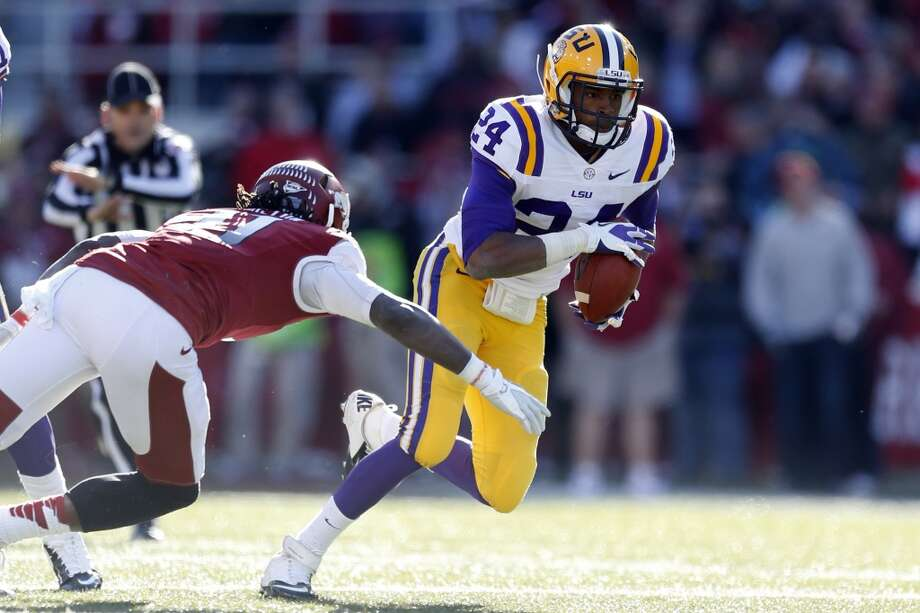 FAYETTEVILLE, AR - NOVEMBER 23:  Tharold Simon #24 of the LSU Tigers runs the ball against the Arkansas Razorbacks at Razorback Stadium on November 23, 2012 in Fayetteville, Arkansas.  (Photo by Wesley Hitt/Getty Images)