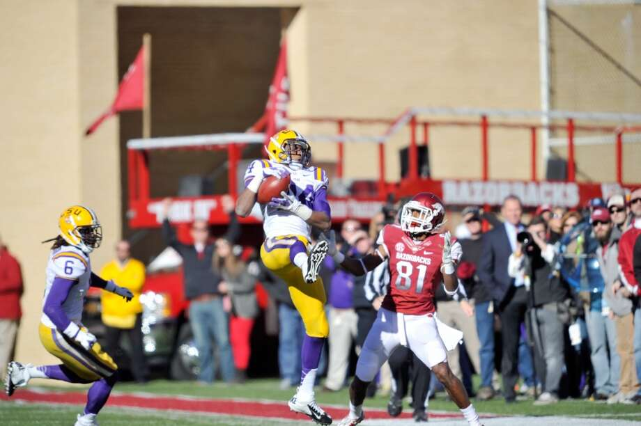FAYETTEVILLE, AR - NOVEMBER 23, 2012: Tharold Simon, #24 cornerback of the Louisiana State University Tigers football team intercepts the ball during the game against the Arkansas Razorbacks on November 23, 2012 at Razorbacks Stadium in Fayetteville, Arkansas. The Tigers won 20-13. (Photo by Steve Franz/Louisiana State University/Collegiate Images/Getty Images)