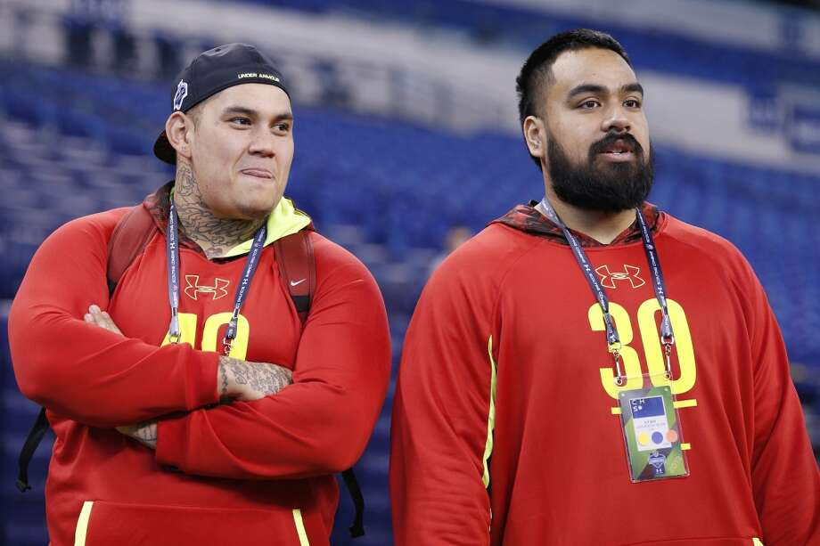 INDIANAPOLIS, IN - FEBRUARY 25: Jesse Williams of Alabama (left) and Star Lotulelei of Utah look on during the 2013 NFL Combine at Lucas Oil Stadium on February 25, 2013 in Indianapolis, Indiana. (Photo by Joe Robbins/Getty Images)