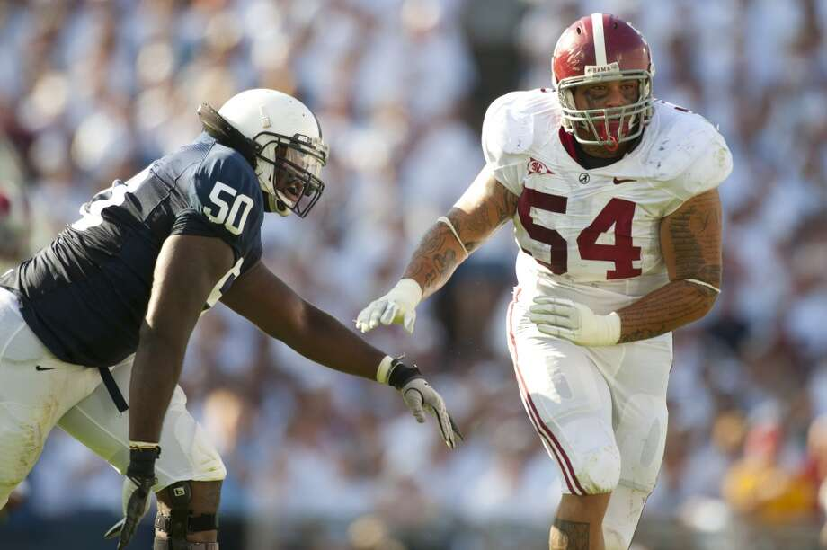 STATE COLLEGE, PA - SEPTEMBER 10: Jesse Williams #54 of the Alabama Crimson Tide defends during the game against the Penn State Nittany Lions at Beaver Stadium on September 10, 2011 in State College, Pennsylvania. Alabama defeated Penn State 27 to 11. (Photo by Rob Tringali/SportsChrome/Getty Images)