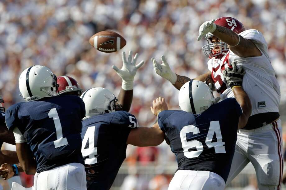 STATE COLLEGE, PA - SEPTEMBER 10: Jesse Williams #54 of the Alabama Crimson Tide blocks a pass thrown by quarterback Rob Bolden #1 of the Penn State Nittany Lions during the first half at Beaver Stadium on September 10, 2011 in State College, Pennsylvania.  (Photo by Rob Carr/Getty Images)