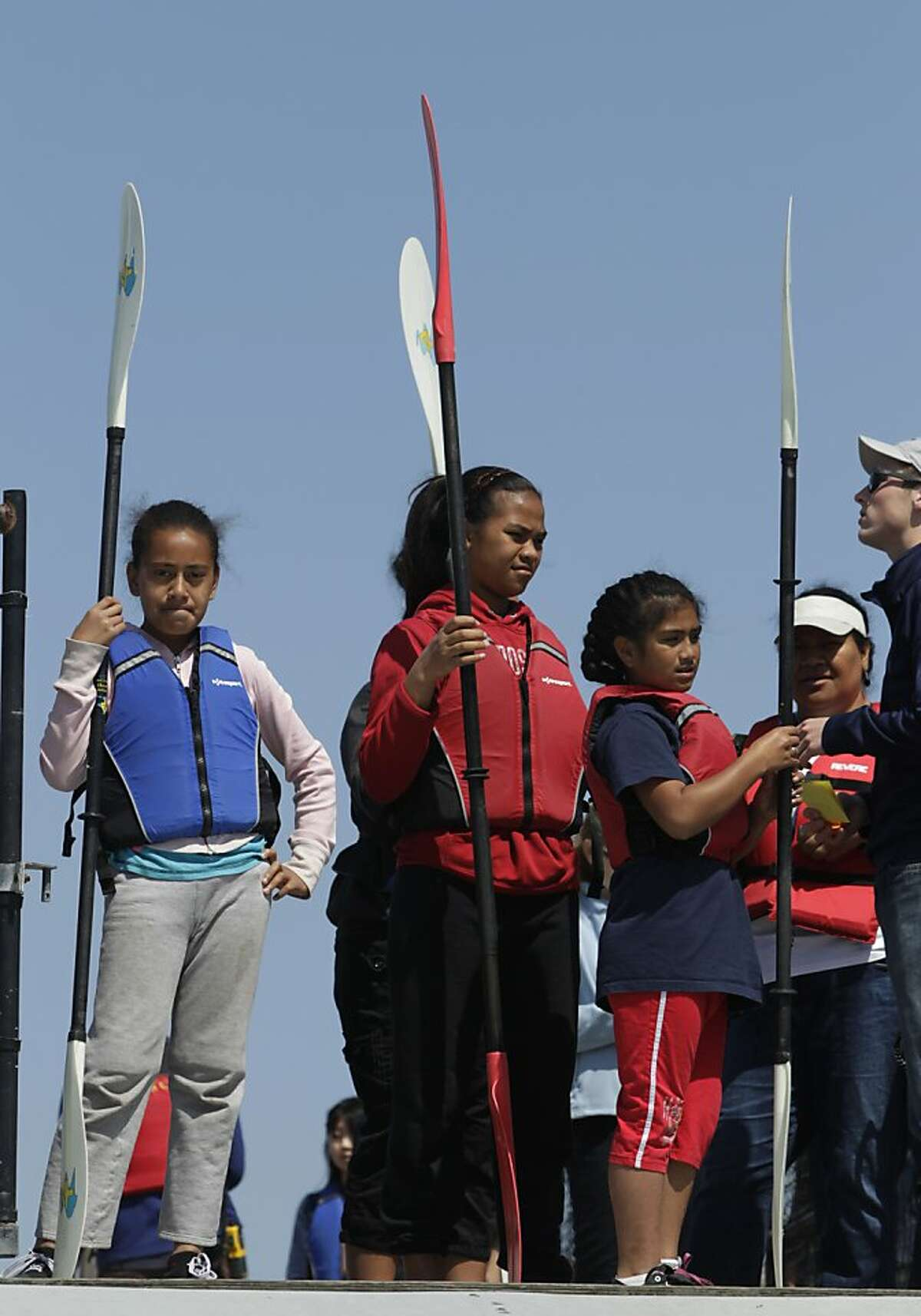 The Fakava family wait to be called to the dock for their turn to paddle kayaks at the Treasure Island Sailing Center in San Francisco, Calif. on the opening weekend of the yachting season on Saturday, April 27, 2013. The Kakavas drove up from Fresno to participate in the free event.