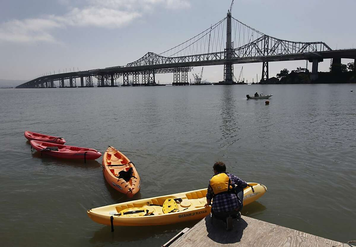 Volunteer Ted Chavkin pulls kayaks to the dock for guests to paddle at the Treasure Island Sailing Center in San Francisco, Calif. during the opening weekend of the yachting season on Saturday, April 27, 2013.