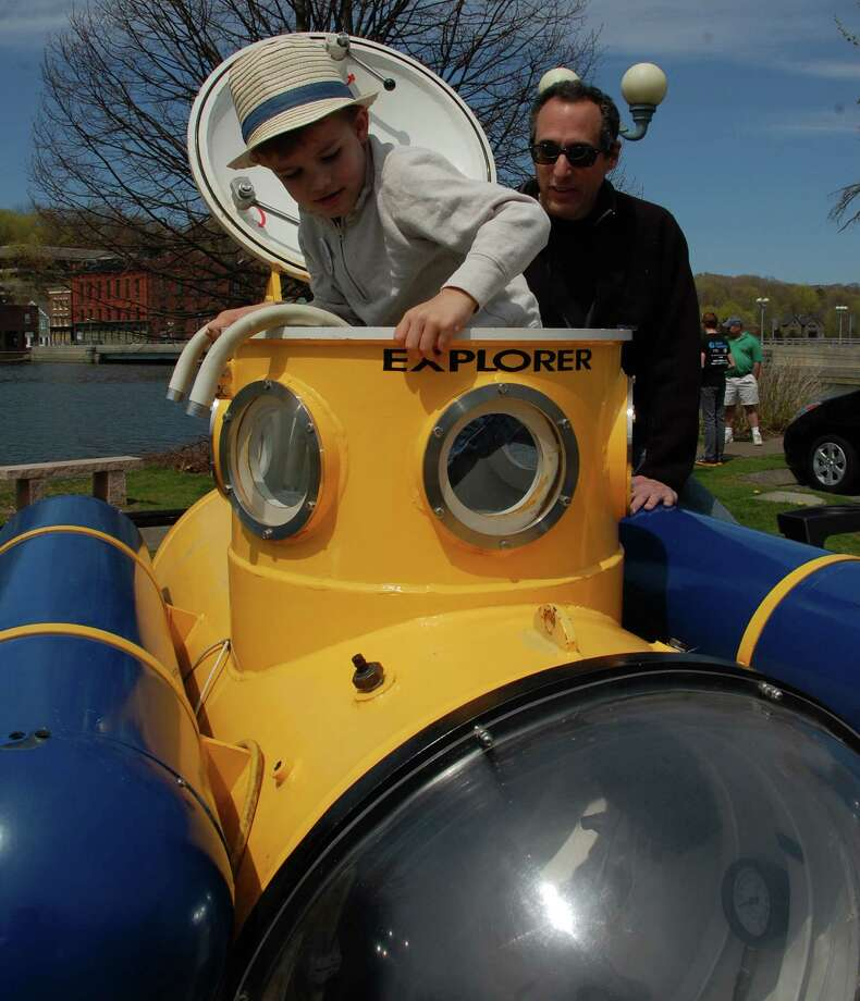 "Alan Winick of Westport made his dream come true when he built this submarine, which he showed at Satursday's Mini Maker Faire . ""It's never too late,"" he said of dreams. Keagan Youngs, 4, of Westport, got a chance to take a peek inside.  WESTPORT NEWS, CT 4/27/13 Photo: Jarret Liotta / Westport News contributed"