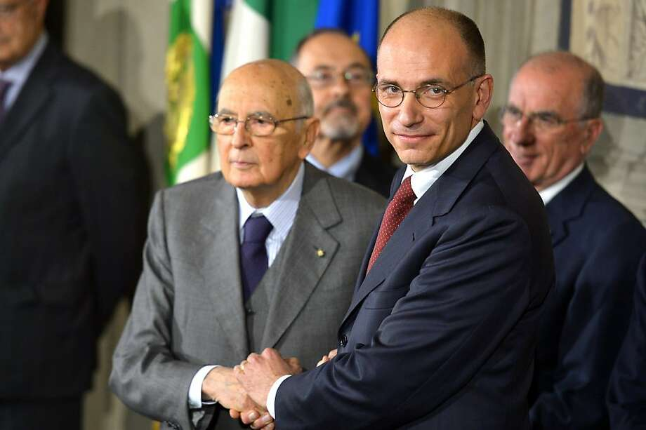 Italian President Giorgio Napolitano (left) shakes incoming Prime Minister Enrico Letta's hand. Photo: Vincenzo Pinto, AFP/Getty Images