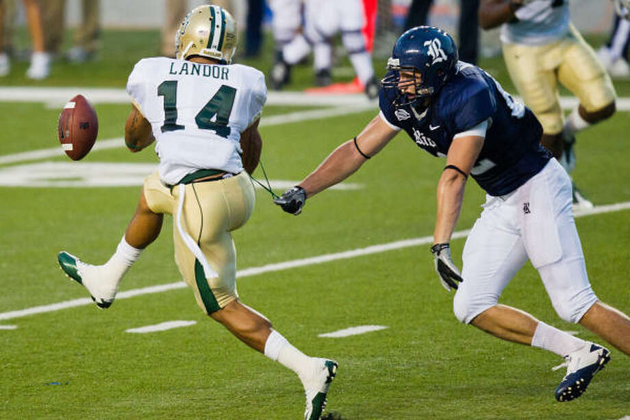 Baylor Bears safety Byron Landor (14) nearly intercepts a pass intended for Rice Owls tight end Luke Willson (82) during the first half of a game in 2010.