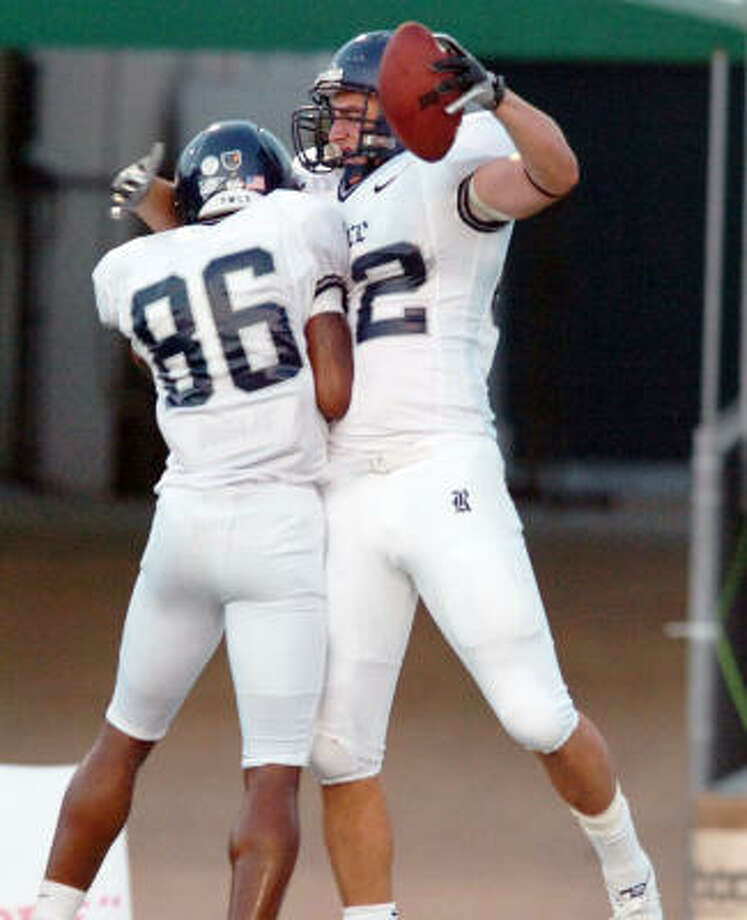 Rice wide receiver Derek Clark (86) and sophomore tight end Luke Willson celebrate after Willson's 22-yard touchdown catch in a 2010 game.