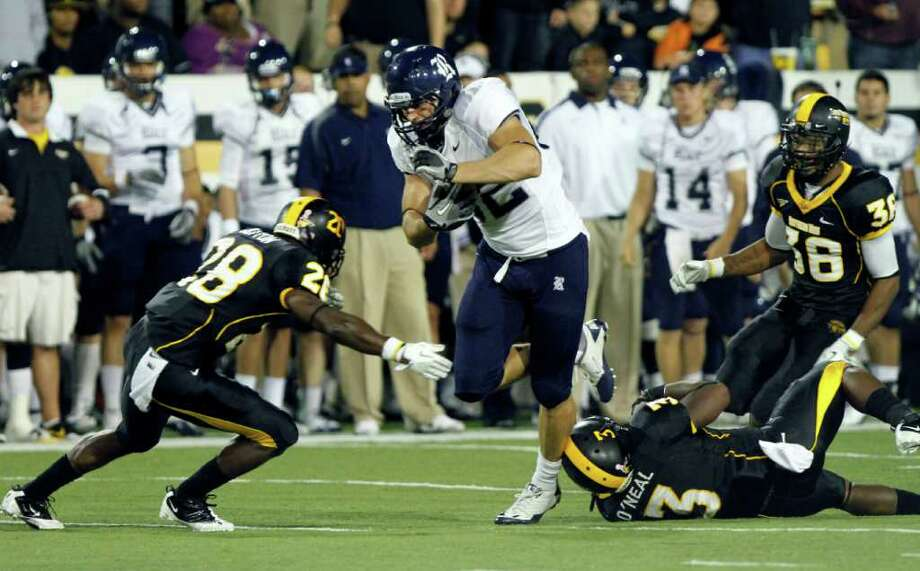 Rice tight end Luke Willson (82) powers past Southern Mississippi defensive back Cameron O'Neal (3) and into defensive back Jacorius Cotton (28) with a second-half, first-down pass reception in their game in Hattiesburg, Miss., on Oct. 1, 2011. Southern Mississippi won 48-24. Photo: Rogelio V. Solis, Associated Press / AP