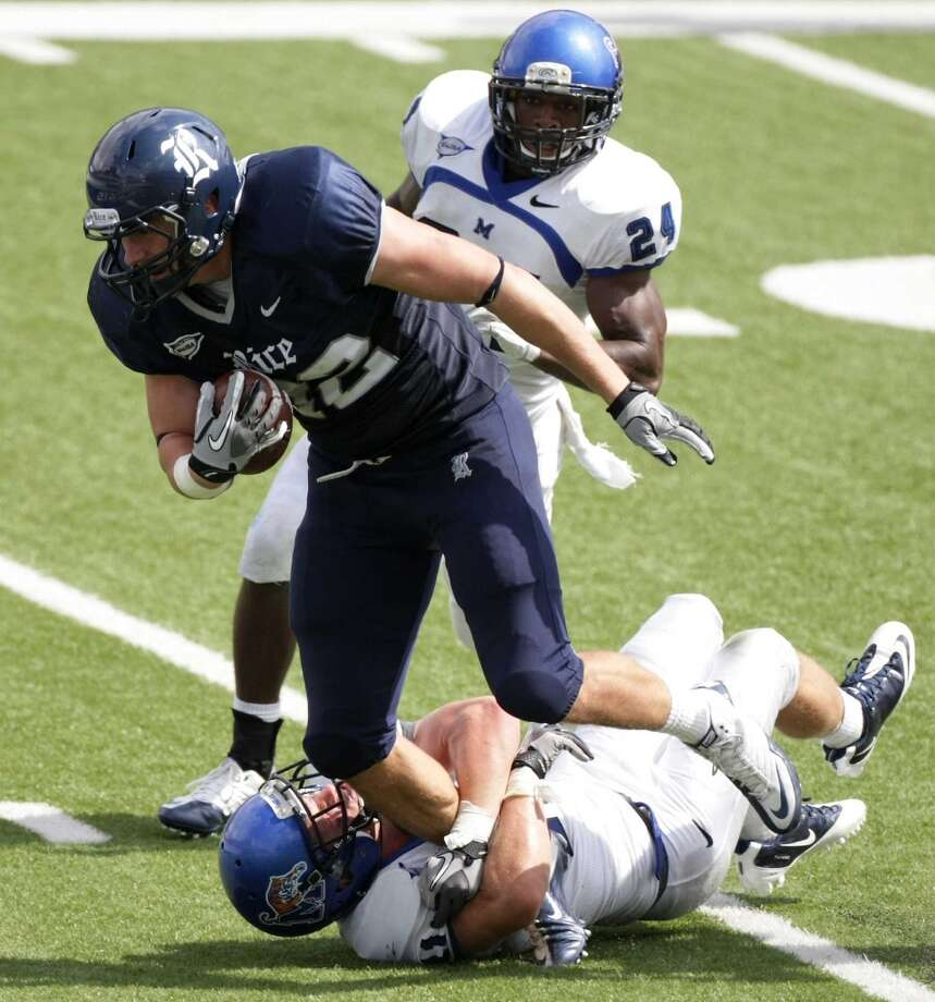 Rice University tight end Luke Willson (82) tries to run over Memphis University defensive back Mitch Huelsing (41) in the third quarter of a game at Rice Stadium in Houston on Oct. 8, 2011. Rice University won 28-6.