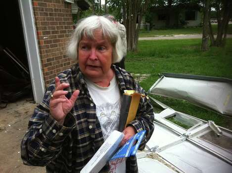 "Jean Smith holds a handicapped parking tag retrieved from her destroyed garage, located inside West's devastated ""Zone 3."" April 27, 2013. Photo: Craig Kapitan / San Antonio Express-News"