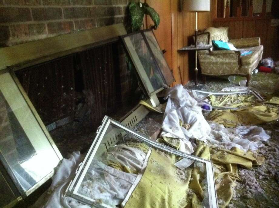 Debris covers George and Jean Smith's living room floor.  April 27, 2013. Photo: Craig Kapitan / San Antonio Express-News