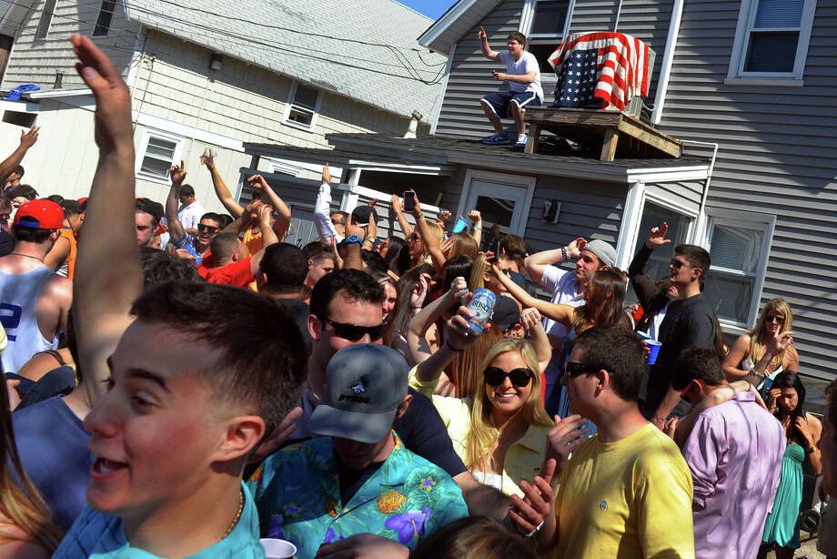 Fairfield University students take part in the annual Clam Jam party in the rental complex at the end of Beach Street in Fairfield, Conn. on Saturday April 27, 2013. There was a heavy police presence in the area, with officers on foot, on horse, and manning sobriety check points. Photo: Christian Abraham / Connecticut Post