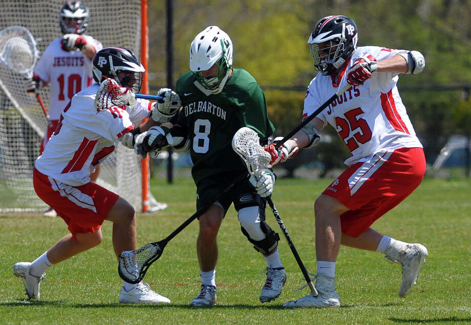Fairfield Prep's Stephen Walsh, left, and teammate Riley Hoffman, right, converge on Delbarton (NJ) player Tom Fowler, during boys lacrosse action at Fairfield University in Fairfield, Conn. on Saturday April 27, 2013. Photo: Christian Abraham / Connecticut Post